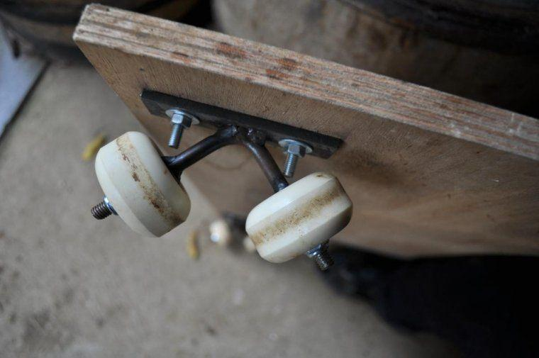 Some nuts and bolts, skateboard wheels, a piece of plywood...