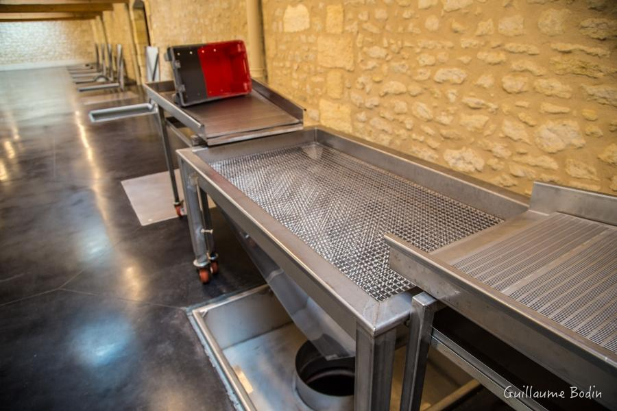 Fully manual sorting system eliminates electricity for the health of the employees and improves the energy in the cellar. With the same number of people as before, the manual brewing and manual picking is as effective as before. – at Chateau Pontet-Canet.